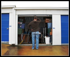 man standing in front of Storage room
