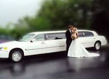 wedding couple near limo
