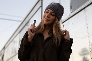 lady holding a portable vaporizer